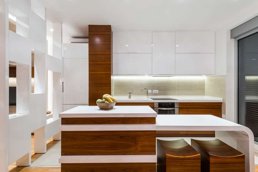 Modern brown and white kitchen with accent wall