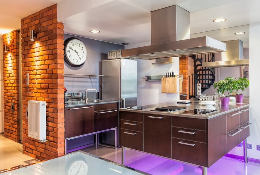 Modern kitchen design with chrome leg island and neon lighting