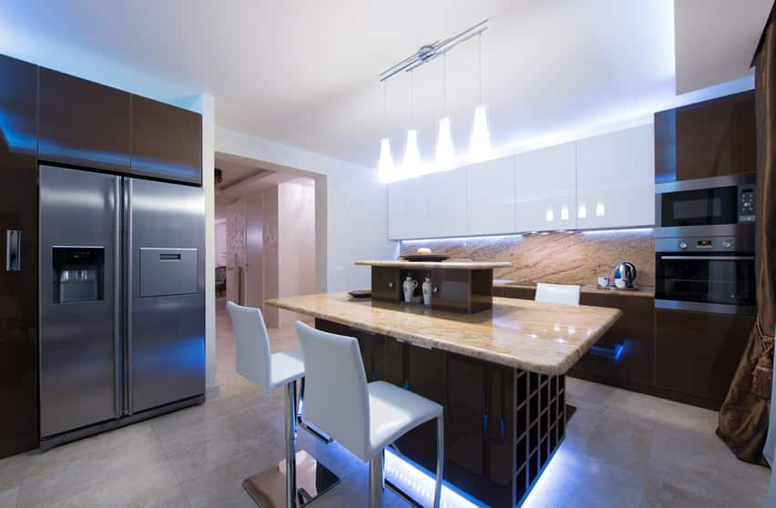 Modern kitchen with large island and floor lighting