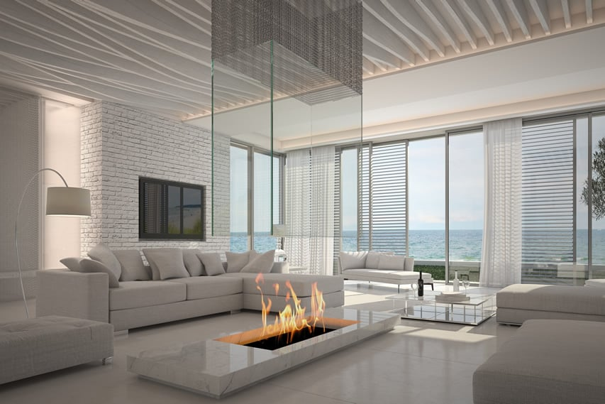 Modern white living room with firepit and ocean view