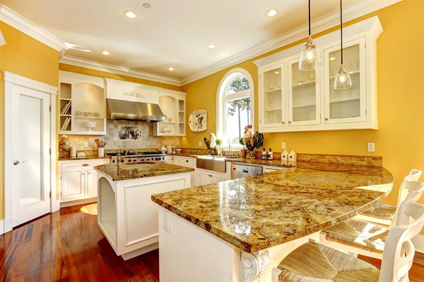 Orange u-shaped kitchen with granite