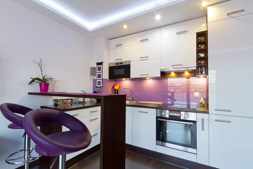 Purple and white theme modern kitchen with purple bar stools