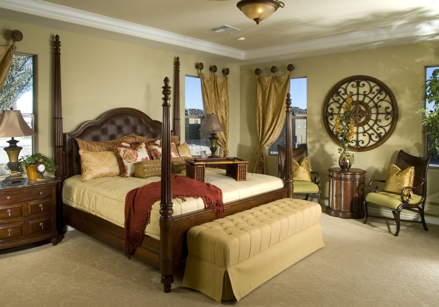 Richly decorated bedroom with yellow and brown tones