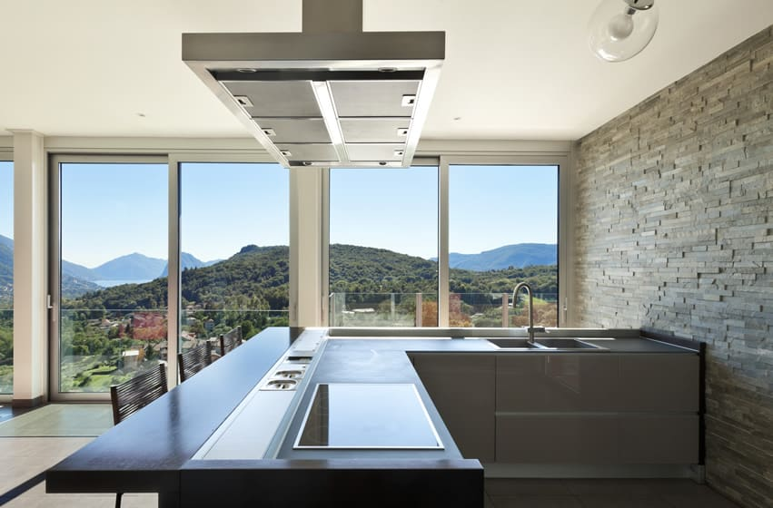 Small l shaped kitchen with impressive view of hills and lake
