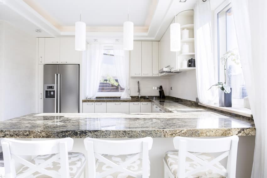 Small white u-shaped kitchen