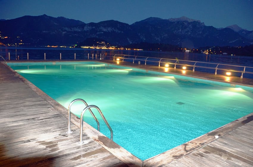 Swimming pool with mountain view and wrap around deck