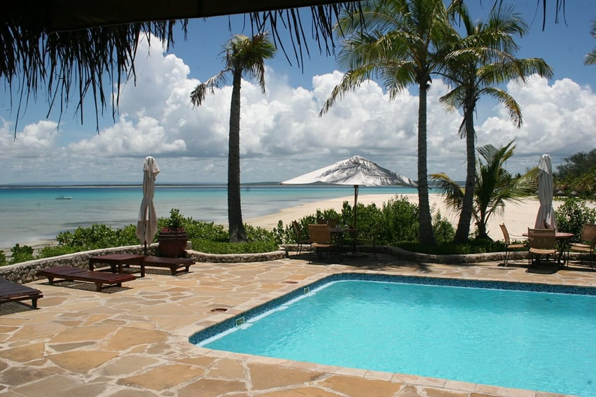 Tropical ocean front swimming pool on the beach.