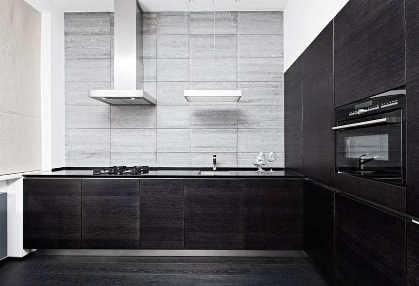 Ultra modern kitchen with black cabinets and gray accent wall