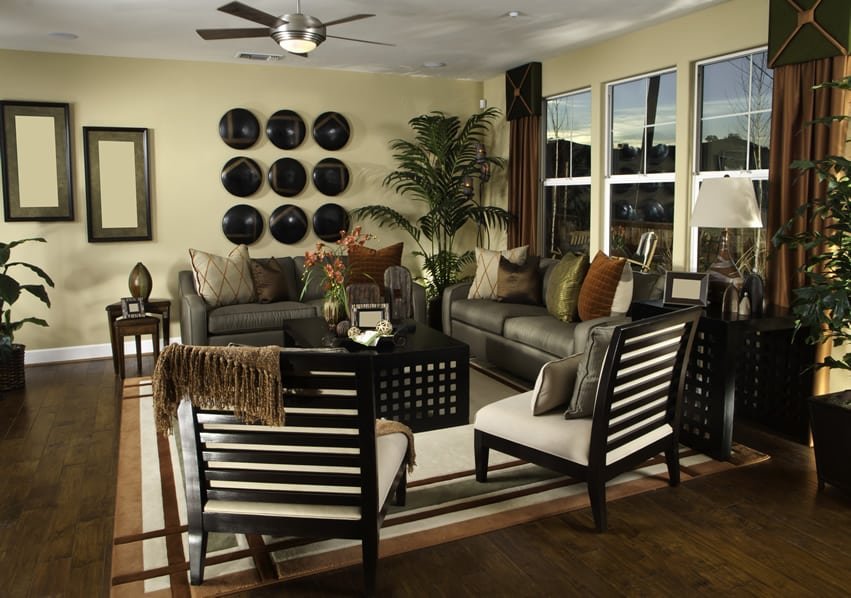 Upscale furnished living room with wood flooring