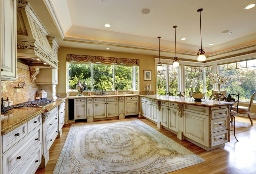Upscale u-shaped kitchen with distressed wood