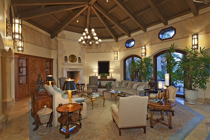 Well furnished living room with vaulted exposed beam ceiling