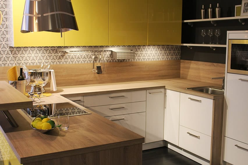 Wood counter u-shaped kitchen with yellow cabinets