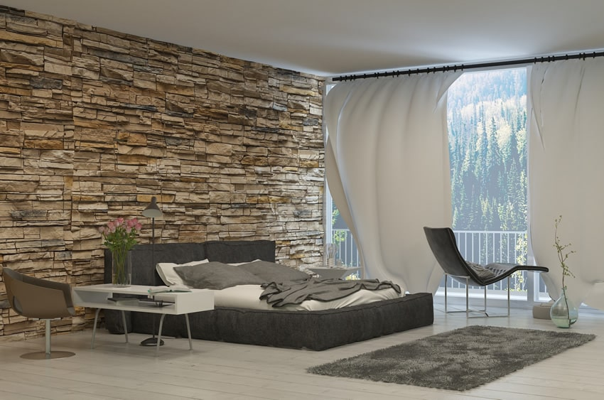 Amazing bedroom with rock accent wall and forest view