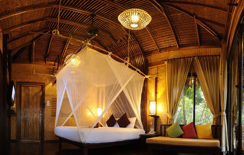 Beautiful tropical vacation villa with curtained bed