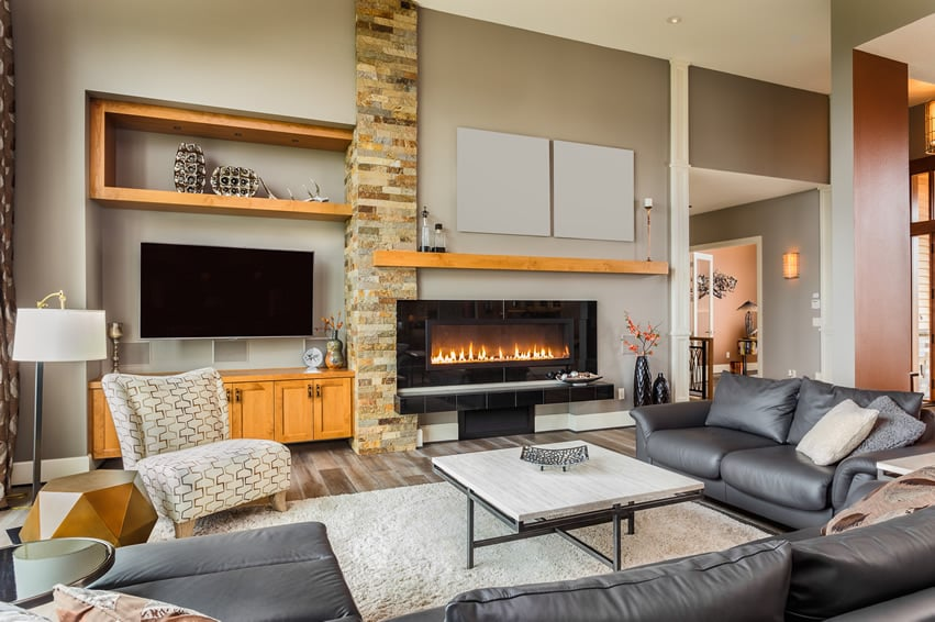 Casual living room with large leather sofa and fireplace