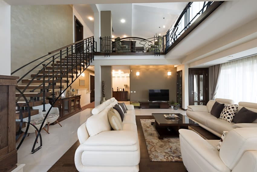 Classy living room with staircase and white & brown theme