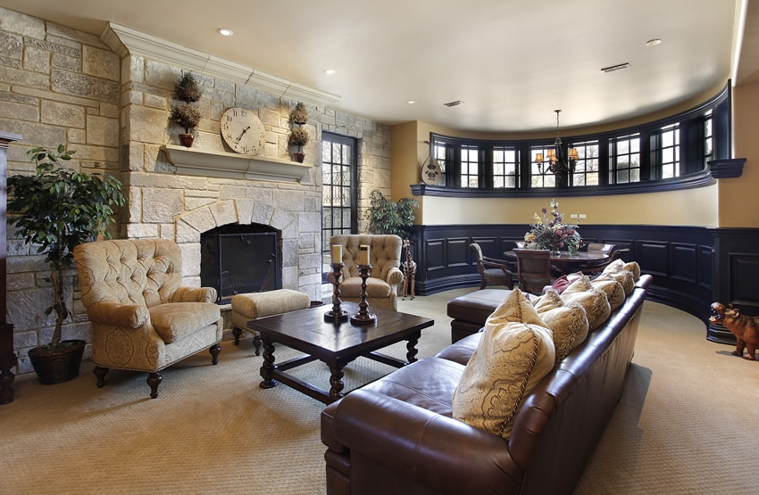 Custom designed living room with large fireplace and circular window area
