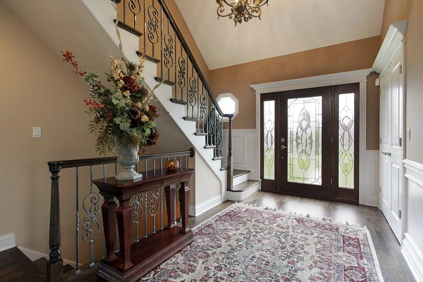 Decorative glass front door at luxury foyer