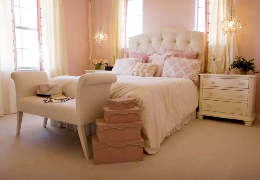 Elegant pink bedroom with cream headboard and furniture