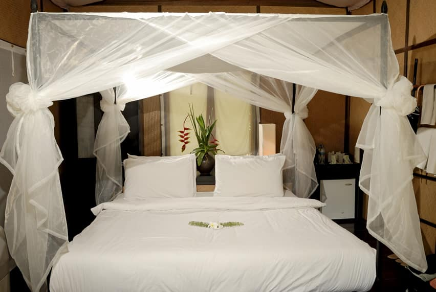 Honeymoon suite at tropical resort with four post bed