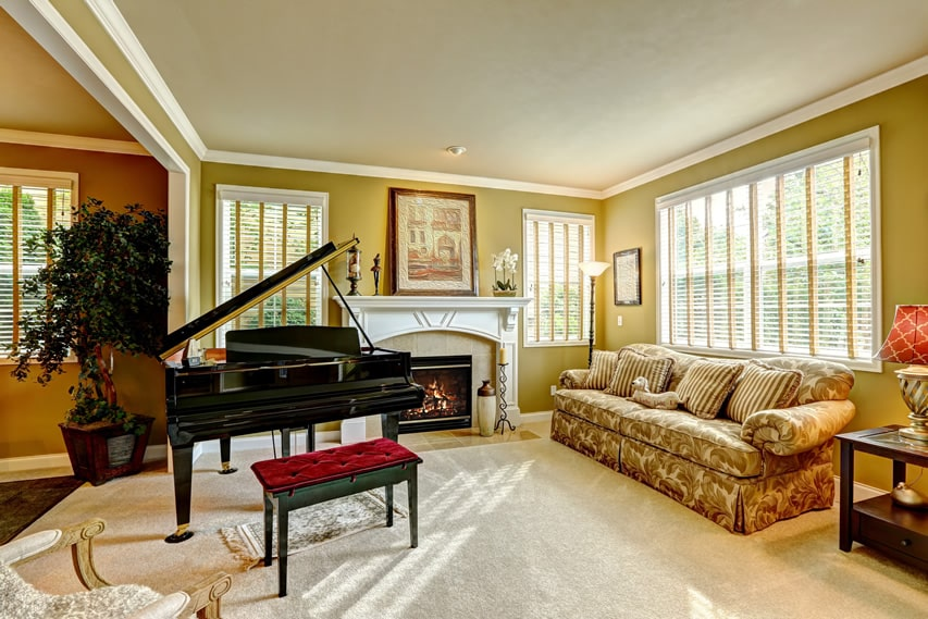 Living room with fireplace and grand piano