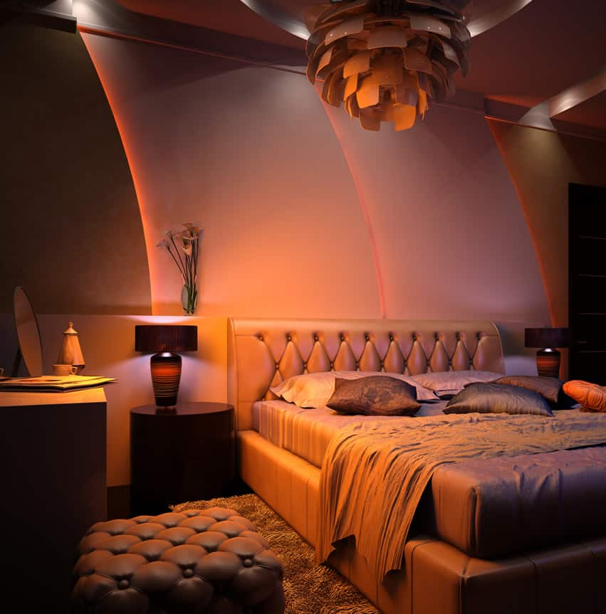 Modern romantic bedroom with leather bedframe and seat