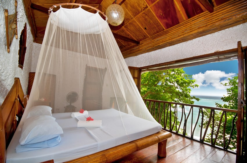 Ocean front bedroom villa with canopy