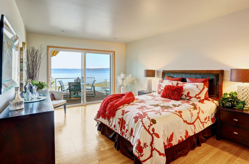 Ocean front bedroom with slider door view and deck