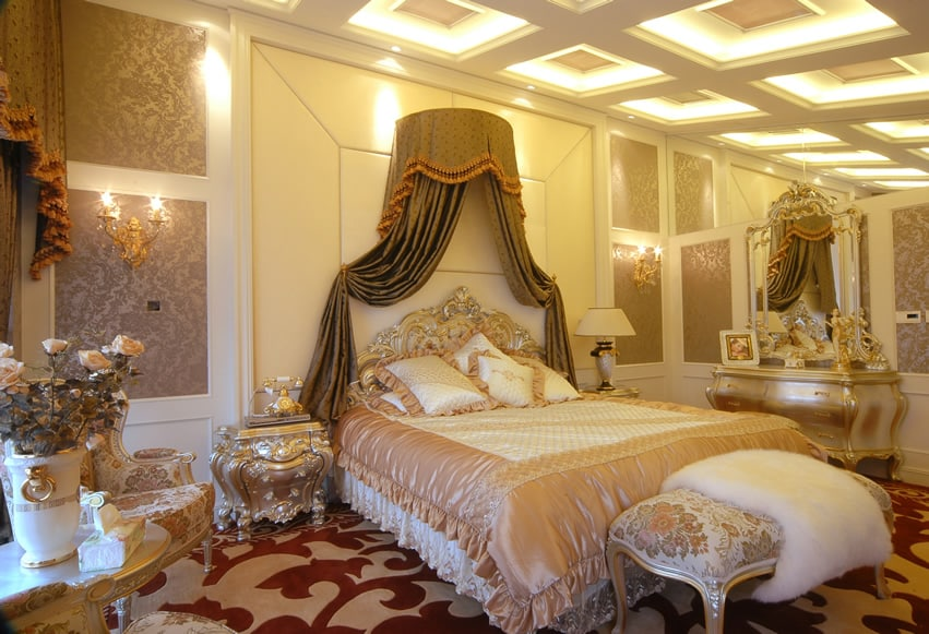 Richly decorated romantic bedroom with bed curtain