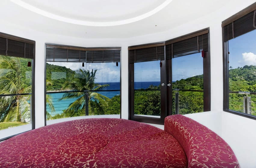 Round bedroom and bed with tropical ocean view