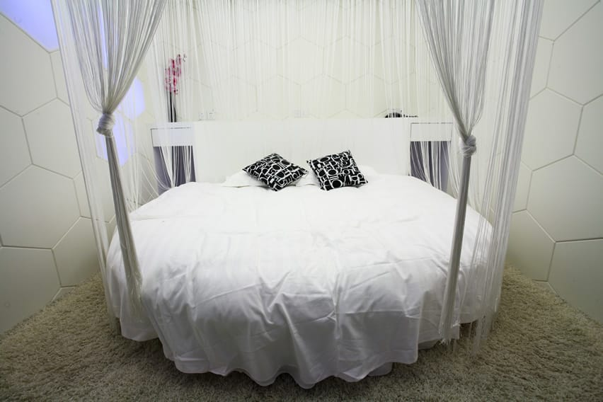 Round shape modern bed with sheer drapery