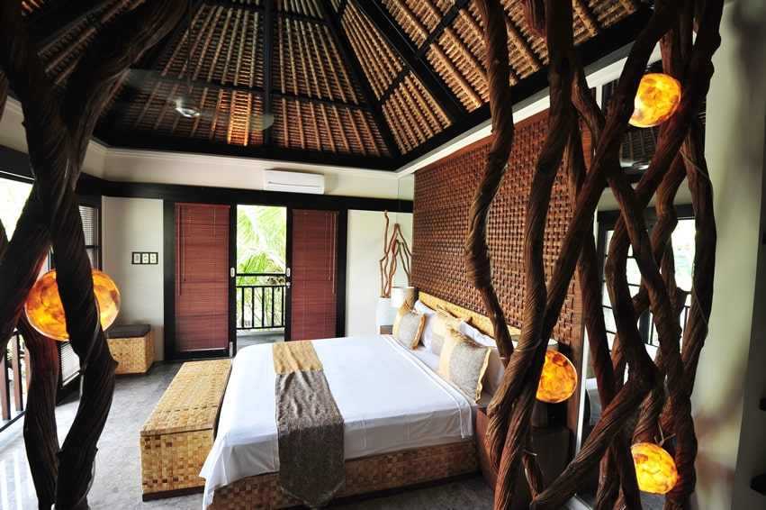 Tropical villa bedroom with vaulted ceiling