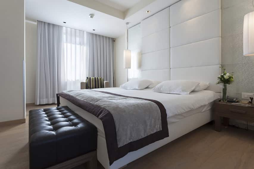 Upscale bedroom at modern hotel