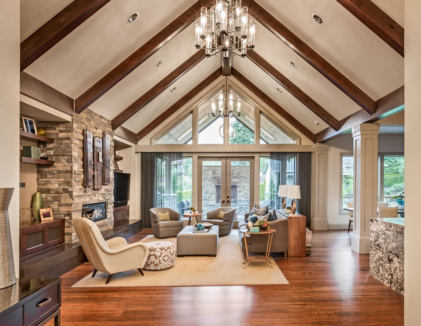 Upscale living room with vaulted ceiling, wood flooring and fireplace