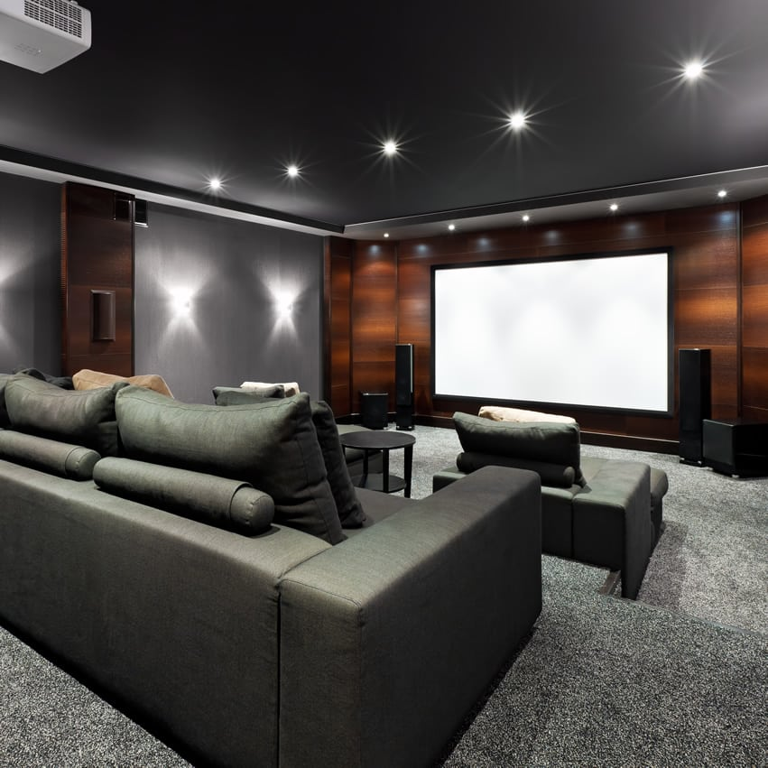 Black and grey home theater with brown accent wall