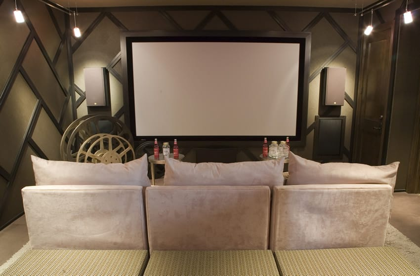 Media room with comfortable couch and tables