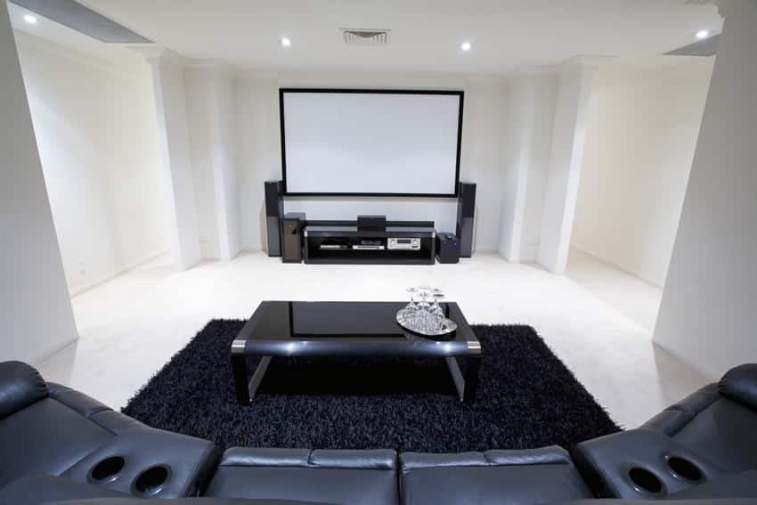 Modern media room with movie screen