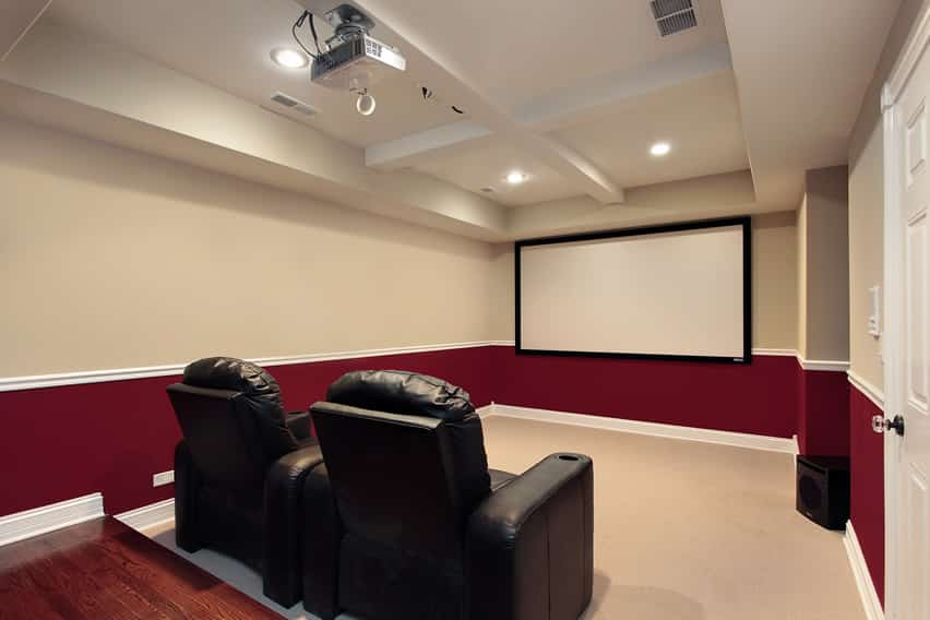 Red and white movie room with projector
