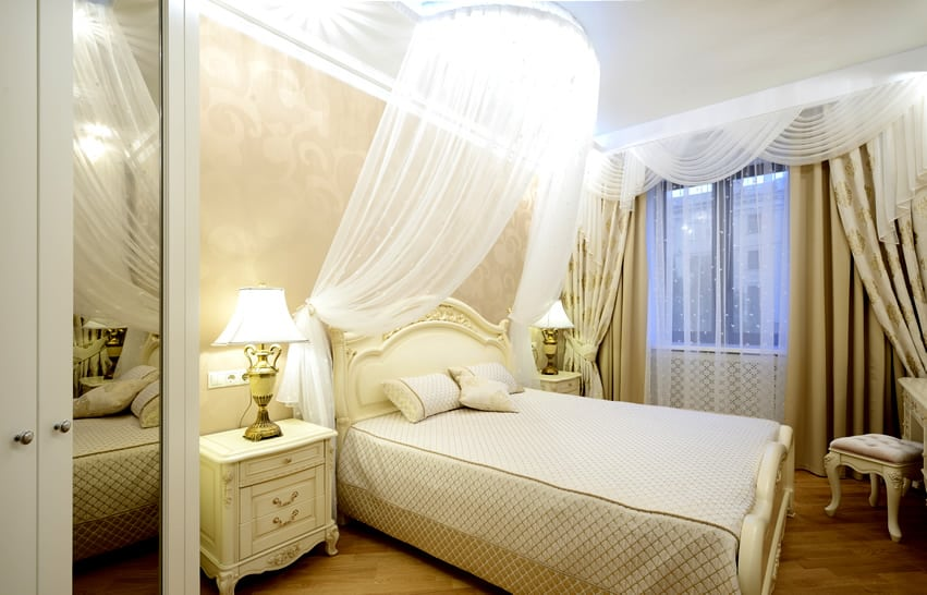 Small bedroom with sheer canopy bed curtain