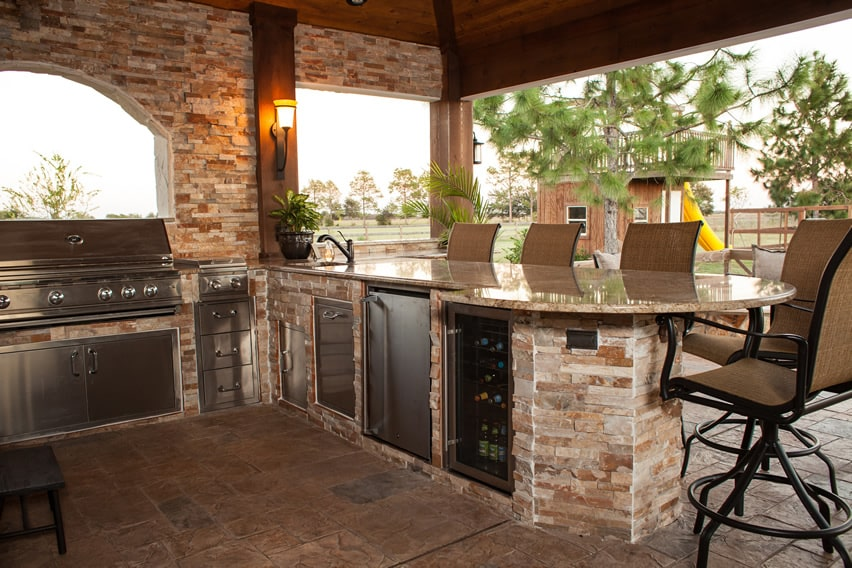 Stone outdoor kitchen with wine fridge