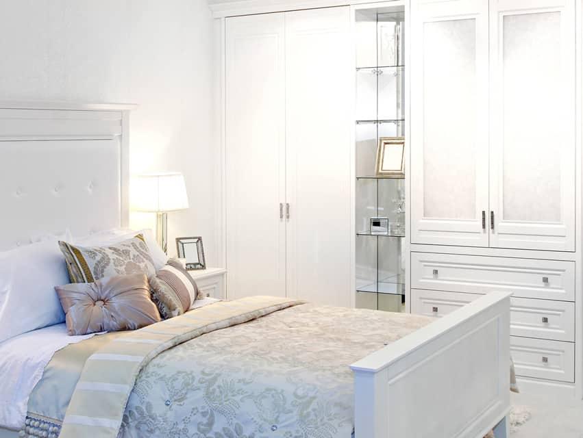 White bedroom wardrobe with glass shelves