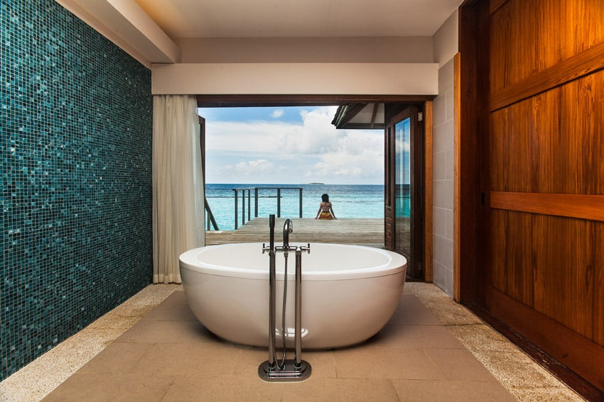 Amazing oceanview bathtub with aqua tile acent wall