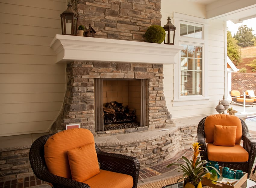 Attractive outdoor patio fireplace with seating