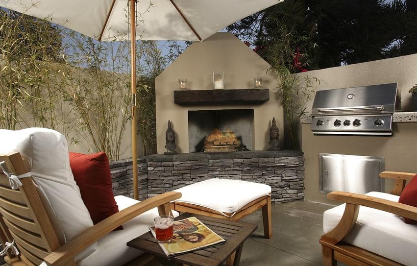 Backyard fireplace on patio with lounge chairs