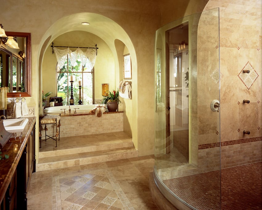 Bathroom with luxury tilework and arched ceiling