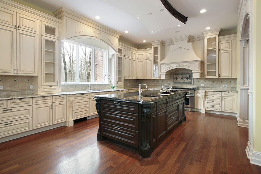 Beautiful white cabinet kitchen with large dark wood island