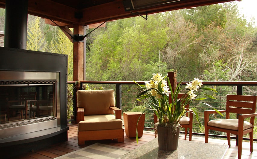Black and silver outdoor fireplace on covered deck