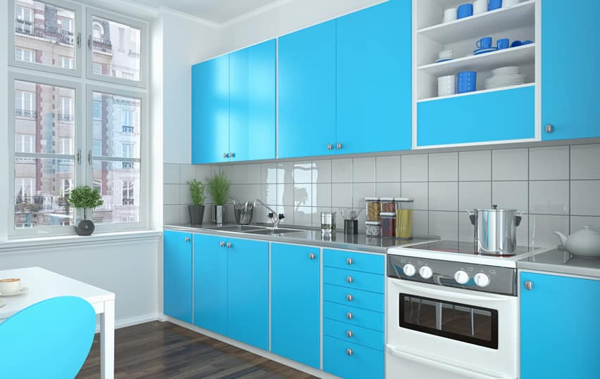 Bright blue modern kitchen with square tile back splash