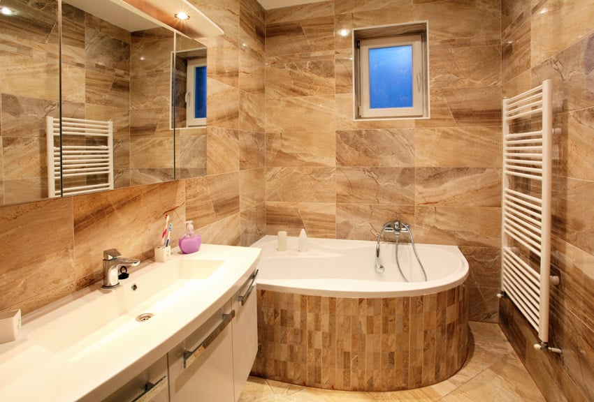 Bathroom in luxury home with large rounded soaking tub