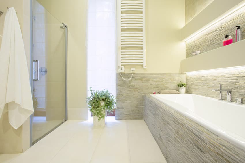 Clean and bright bathroom design with light yellow paint